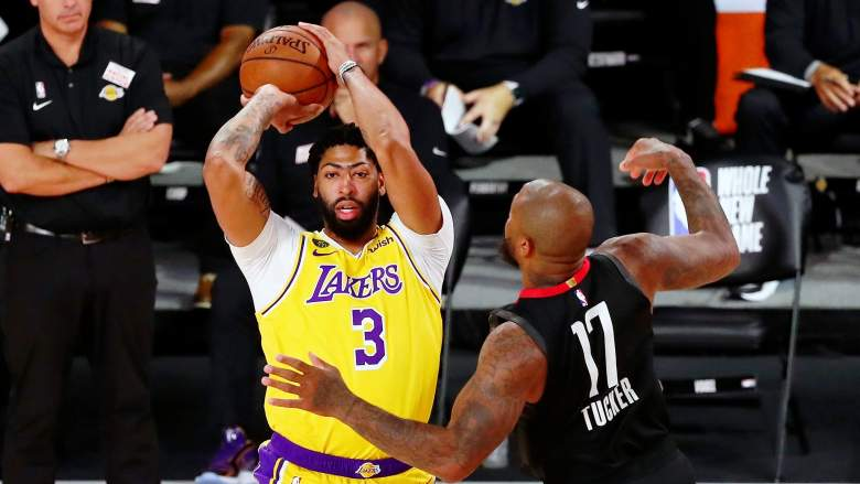 Lakers big man Anthony Davis, at left, guarded by P.J. Tucker of the Rockets.