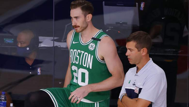 Gordon Hayward, left, checks in as Boston Celtics coach Brad Stevens looks on.