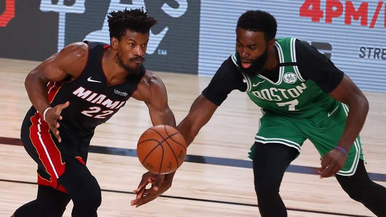 Celtics' forward Jaylen Brown, right, fights for a loose ball with Miami's Jimmy Butler.
