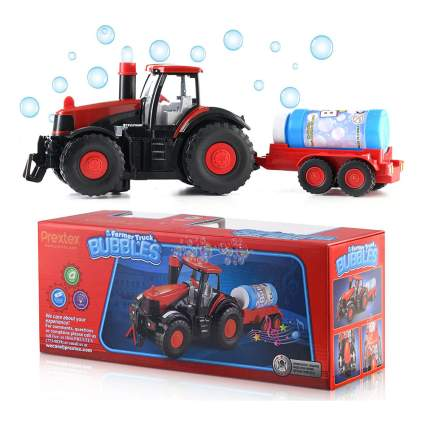 Red toy tractor that blows bubbles