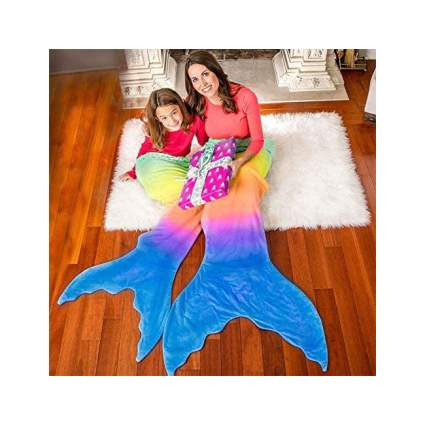 Mom and daughter in matching mermaid tails