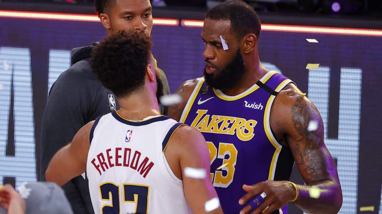 The Lakers' Lebron James, right, speaks to Jamal Murray of the Nuggets, left.