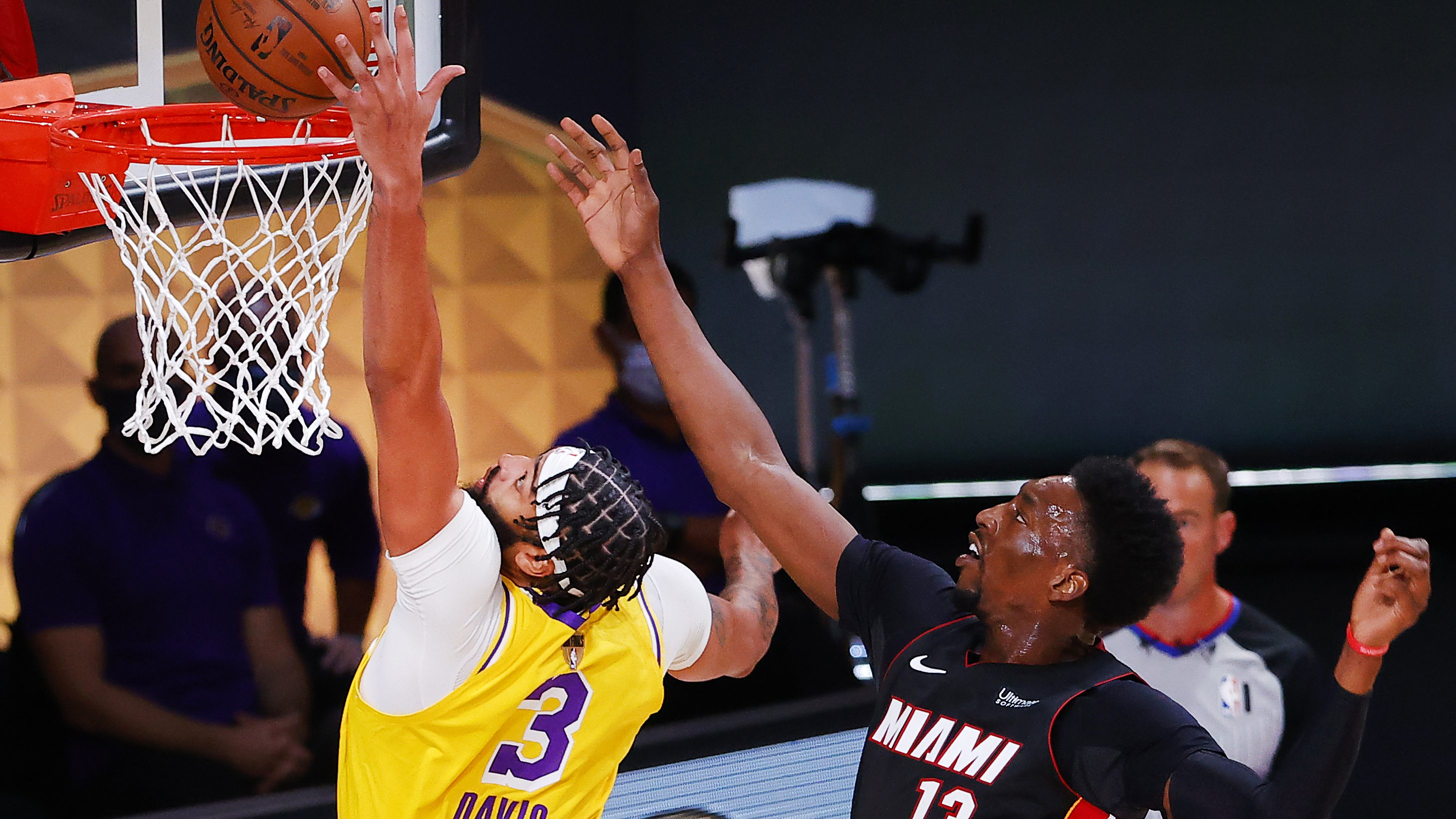 Anthony Davis, left, of the Lakers got the better of now-injured Bam Adebayo in Game 1 of the Finals.