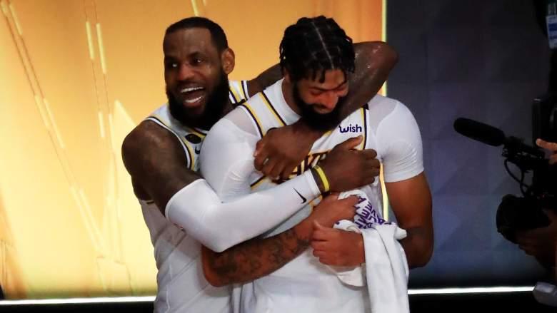 Anthony Davis, right, celebrates with Lakers teammate LeBron James