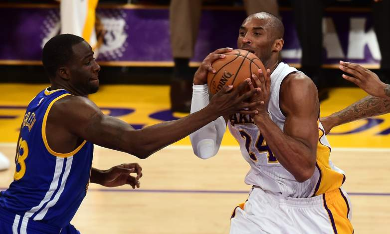 Kobe Bryant drives against Draymond Green