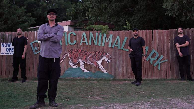 Zak and crew standing in front of entrance sign at the Greater Wynnewood Exotic Animal Park.
