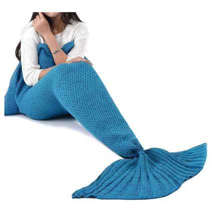 woman in blue mermaid blanket