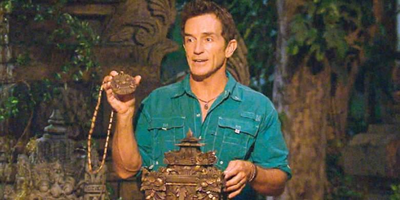 Survivor host Jeff Probst holds a hidden immunity idol necklace.