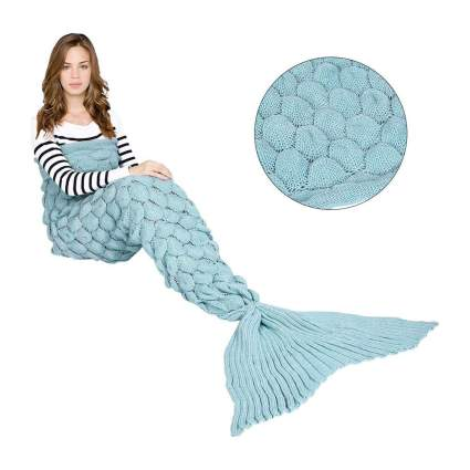 Woman with light blue fish scale blanket