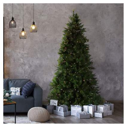 Christmas tree in living room with gifts