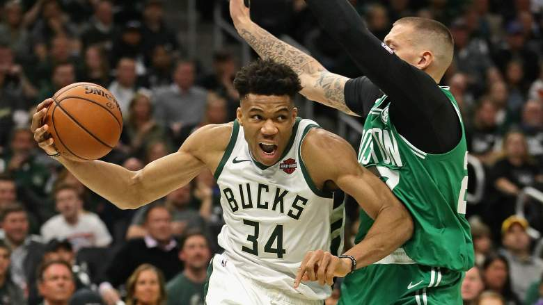 Giannis Antetokounmpo (left) and the Bucks should be a tougher challenge now for Daniel Theis (right) and the Celtics.