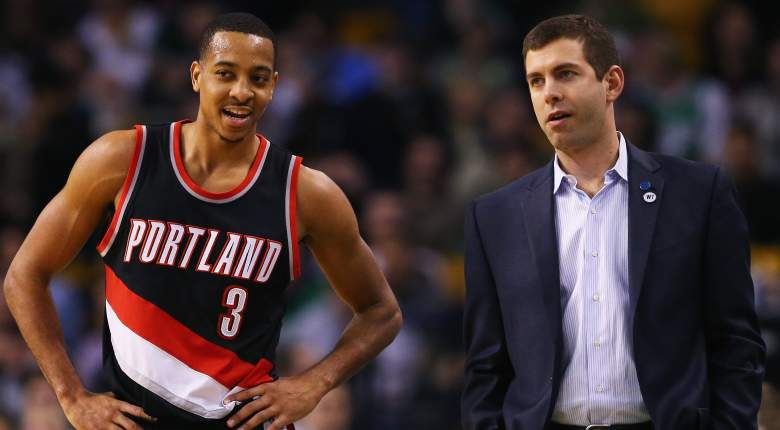 Guard CJ McCollum of the Trail Blazers and Boston Celtics coach Brad Stevens.