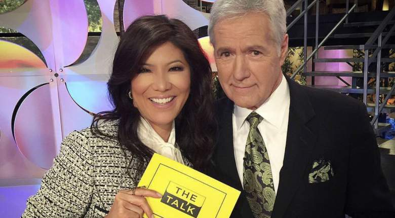 Julie Chen and Alex Trebek pose for a photograph on the set of The Talk