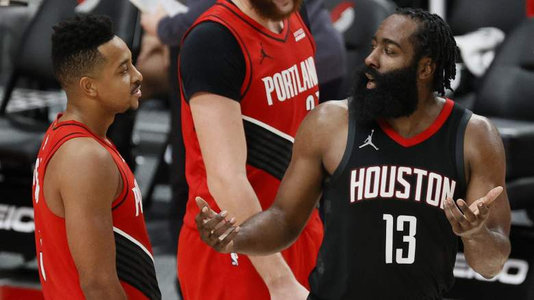 C.J. McCollum, left, jaws with James Harden of the Houston Rockets.