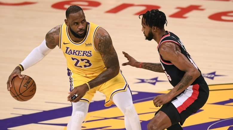 Derrick Jones Jr., right, guards Lakers star LeBron James.