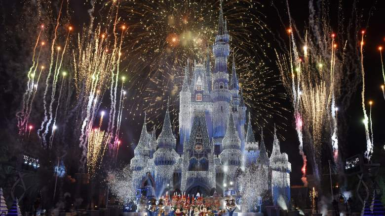 In this handout photo provided by Disney Parks, a view of fireworks, holiday lights and fanfare at Cinderella's Castle