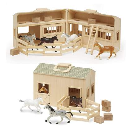 Wooden fold and go stable for toy horses