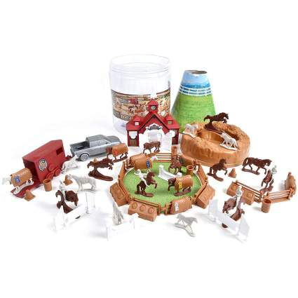 Big pile of small plastic horse and farm toys