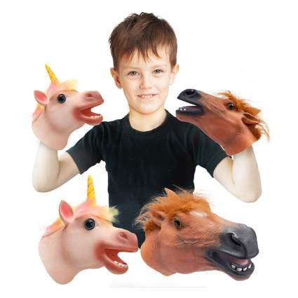 child with horse head hand puppets