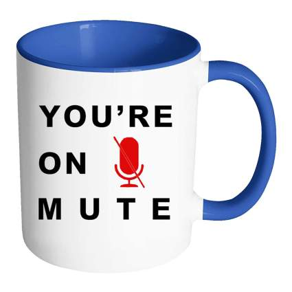 "Blue coffee mug that says ""You're on Mute"""