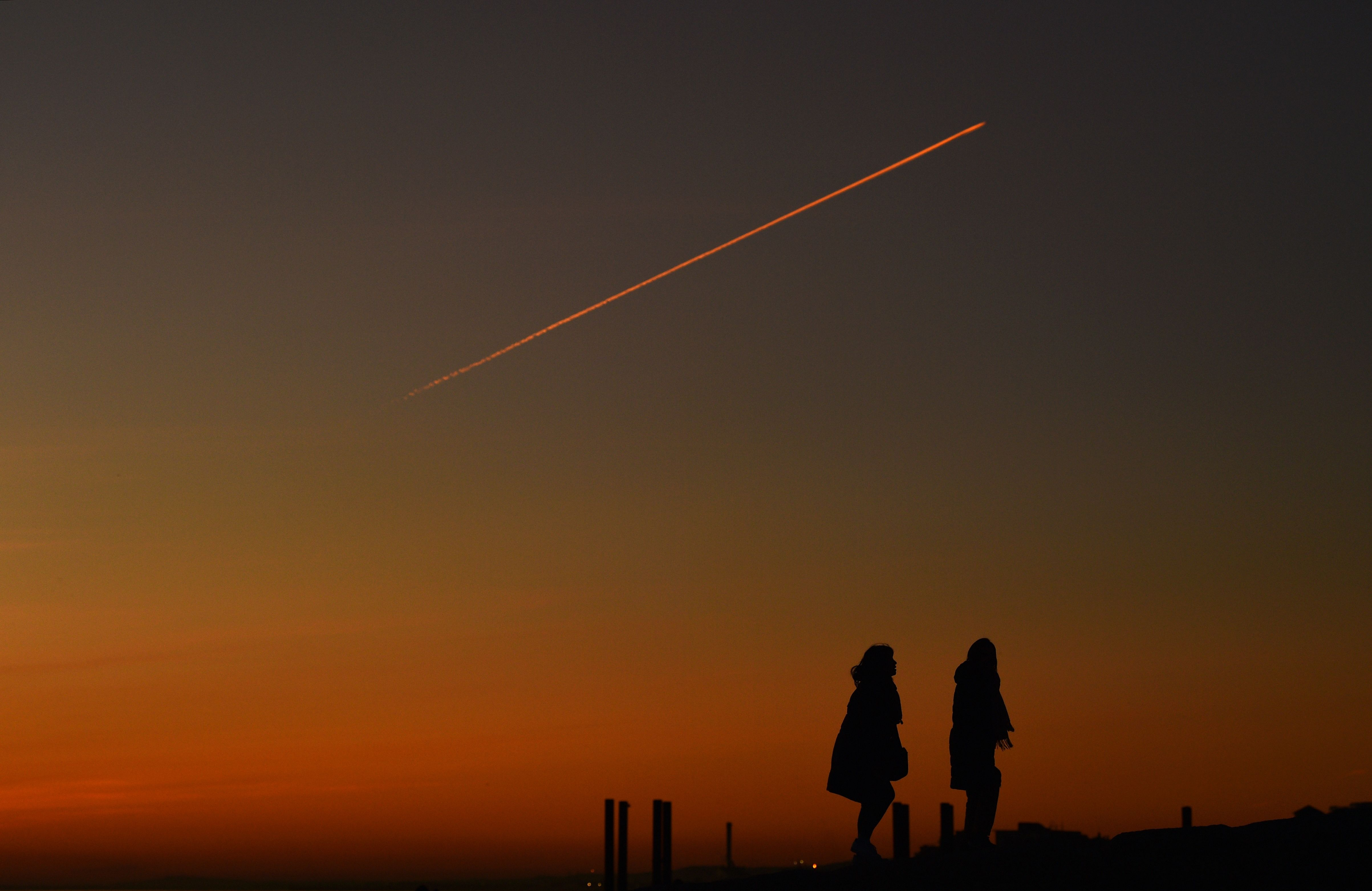 contrails or meteors