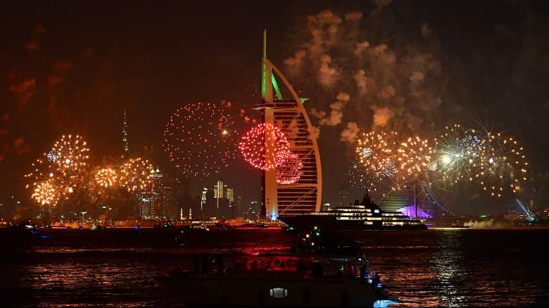 New Year's fireworks celebrations are seen above the Dubai skyline with the Burj Al Arab (R) and Burj Khalifa (L), the world's tallest building, on December 31, 2019.