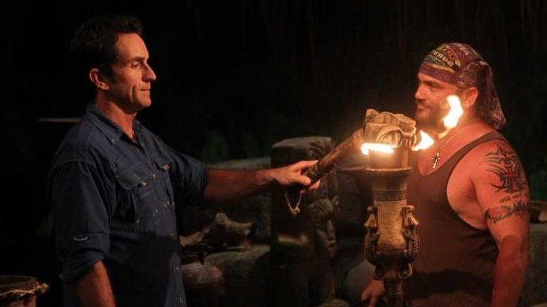 Survivor host Jeff Probst snuffs Russell Hantz's torch