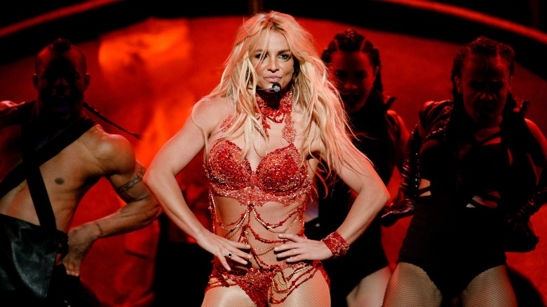 Britney Spears performs in a red leotard.