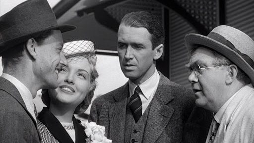From l to r, Todd Karns, Virginia Patton, Jimmy Stewart, and Thomas Mitchell in It's a Wonderful Life.