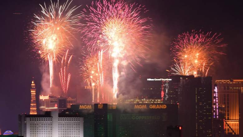 """Fireworks illuminate the skyline over the Las Vegas Strip during an eight-minute-long pyrotechnics show put on by Fireworks by Grucci titled """"America's Party"""" during a New Year's Eve celebration on January 1, 2019 in Las Vegas, Nevada."""