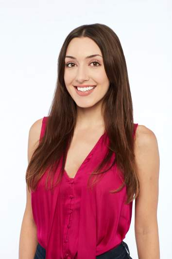Alana from 'The Bachelor' wearing a red top.