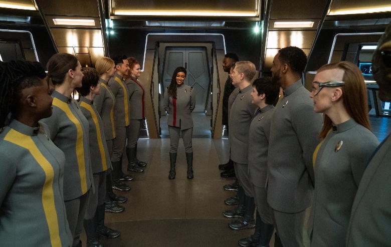 Burnham walking onto the Bridge with her crew members lined up