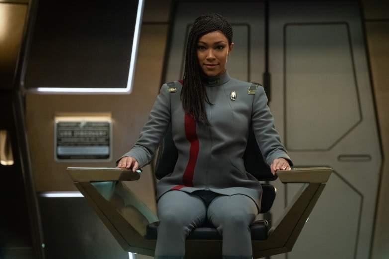Burnham sitting in the Captain's chair