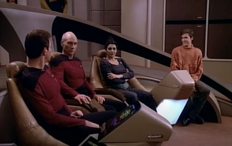 Jonathan Frakes as William Riker, Patrick Stewart as Jean-Luc Picard, Marina Sirtis as Deanna Troi, and Wil Wheaton as Wesley Crusher on the bridge of the Enterprise on Star Trek the Next Generation