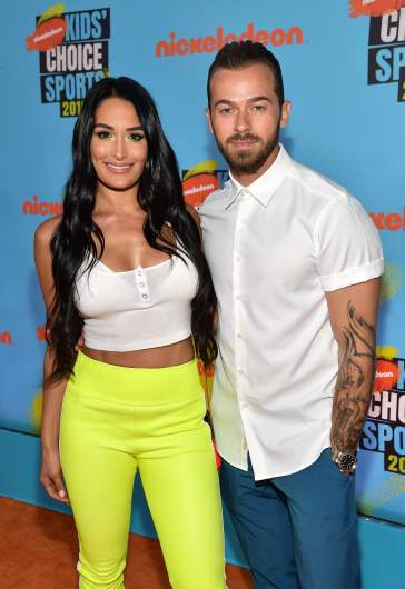 Nikki Bella (L) and Artem Chigvintsev attend Nickelodeon Kids' Choice Sports 2019 at Barker Hangar.