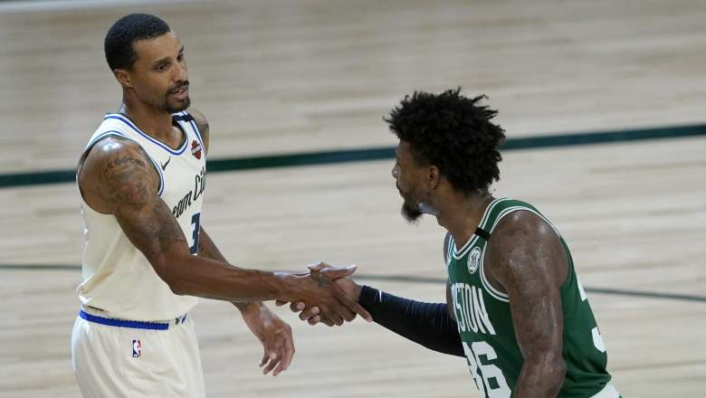 George Hill (left) and Celtics guard Marcus Smart