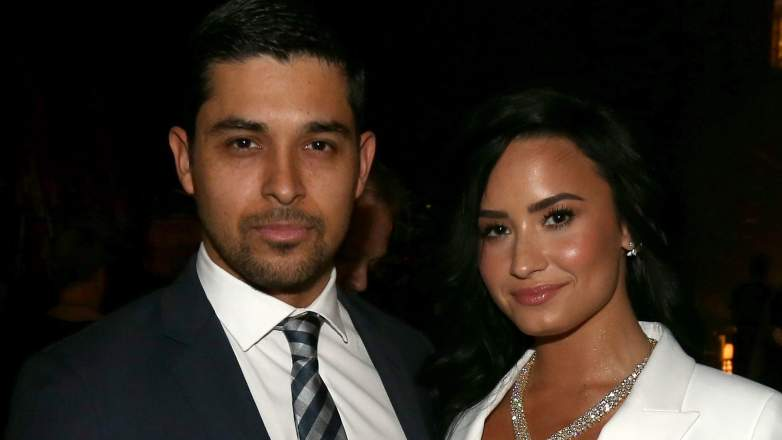 Actor Wilmer Valderrama (L) and singer Demi Lovato attend The 58th GRAMMY Awards