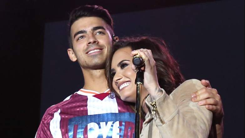 Recording artists Joe Jonas of DNCE (L) and Demi Lovato perform onstage during the Demi Lovato and DNCE Concert for Marriott Rewards members
