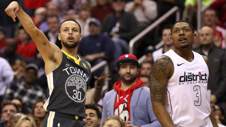 Warriors guard Stephen Curry, left, and Bradley Beal of the Wizards