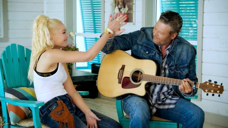 Gwen Stefani and Blake Shelton high-five each other during a benefit concert live stream..