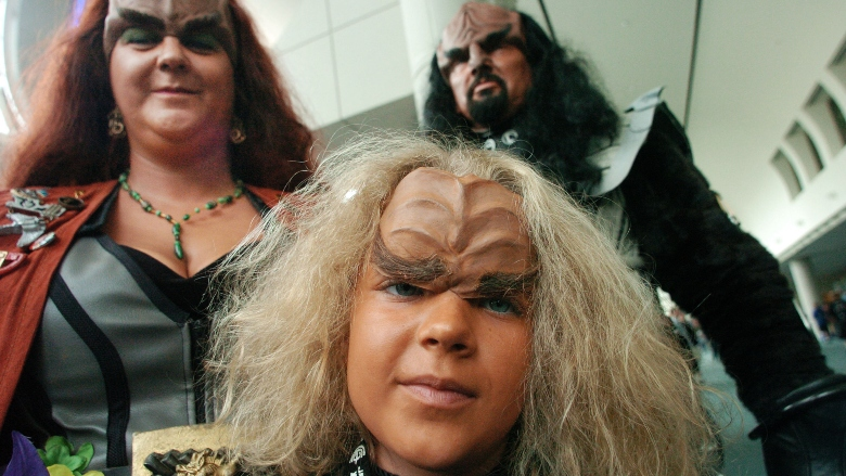Tailyn Jones 7, shows her Klingon costume with her parents Joan and Brett during the Comic-Con Convention