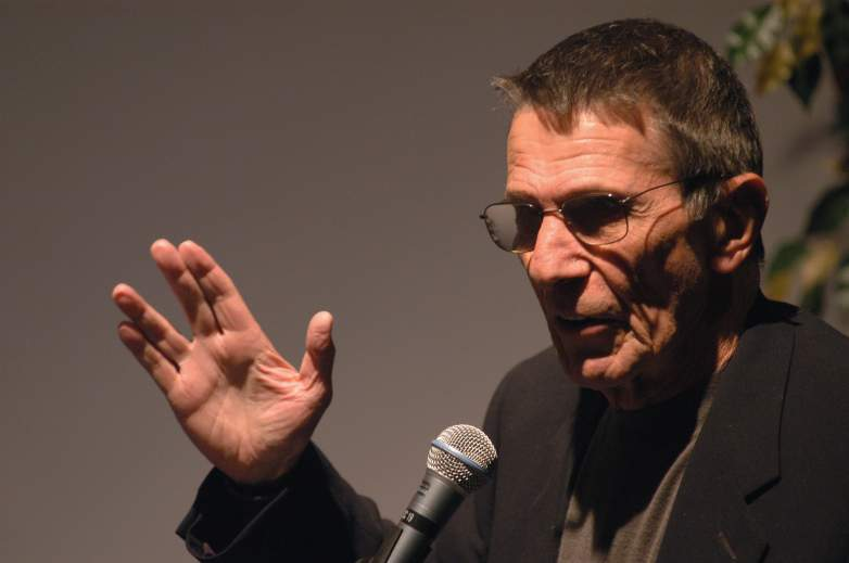 Actor Leonard Nimoy does the vulcan salute as he presents his photography exhibition