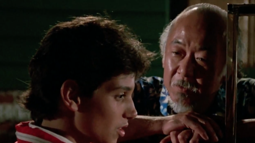 Mr. Miyagi (Pat Morita) gifts Daniel LaRusso (Ralph Macchio) a car for his birthday.