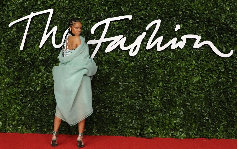 Rihanna poses on the red carpet upon arrival at The Fashion Awards 2019 in London on December 2, 2019