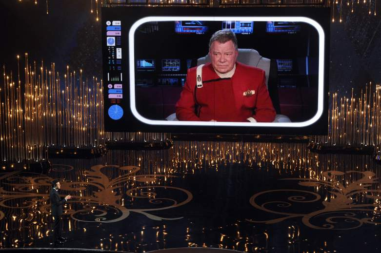 Seth MacFarlane talks to actor William Shatner on the video screen during the Oscars
