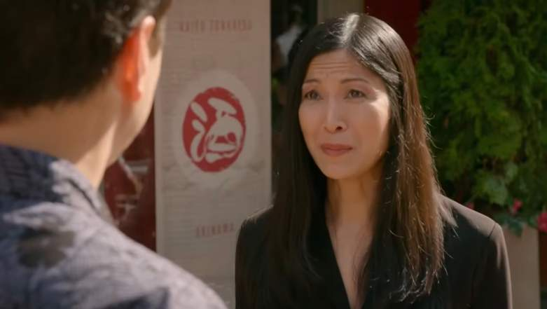 Daniel (Ralph Macchio) speaks to Yuna (Traci Toguchi) in Cobra Kai