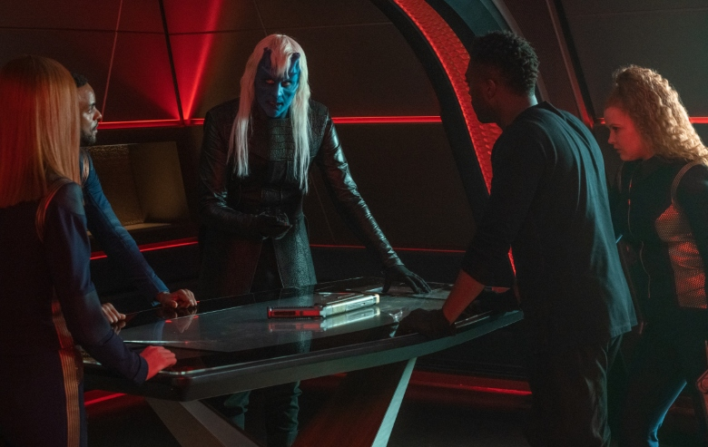 The bridge crew, Book, and Ryn stand in a conference room on Discovery
