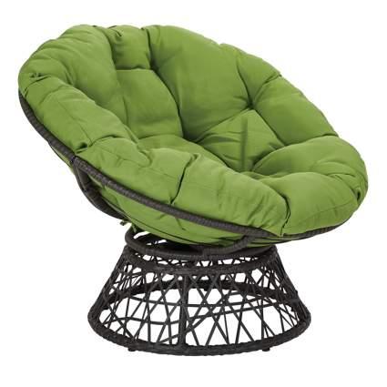 papasan chair with green cushion