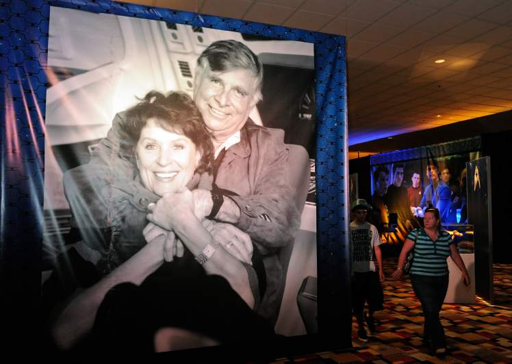 A double-sided vinyl scrim of Gene and Majel Roddenberry is displayed at Julien's Auctions annual summer sale