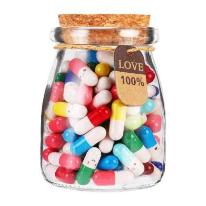 Glass bottle of colorful pills